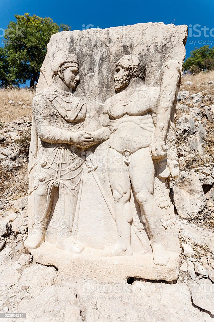 King Mithridates shaking hands with Herakles. stock photo