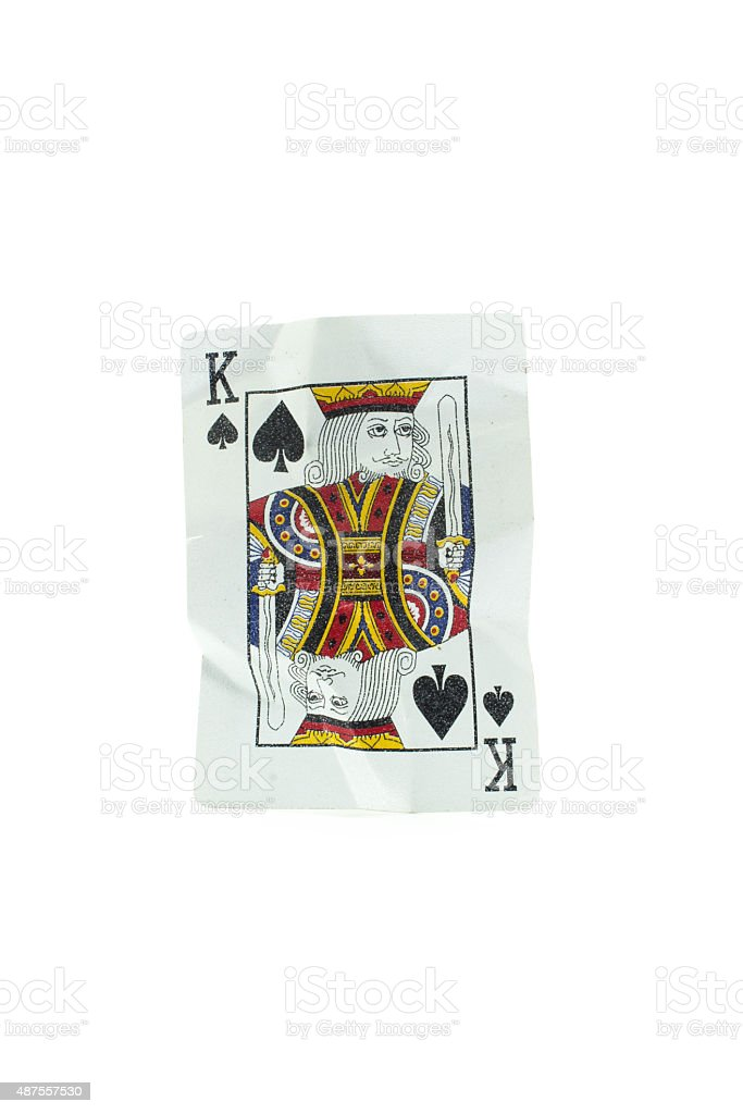 King of Spades Crumpled Playing Cards on white background stock photo