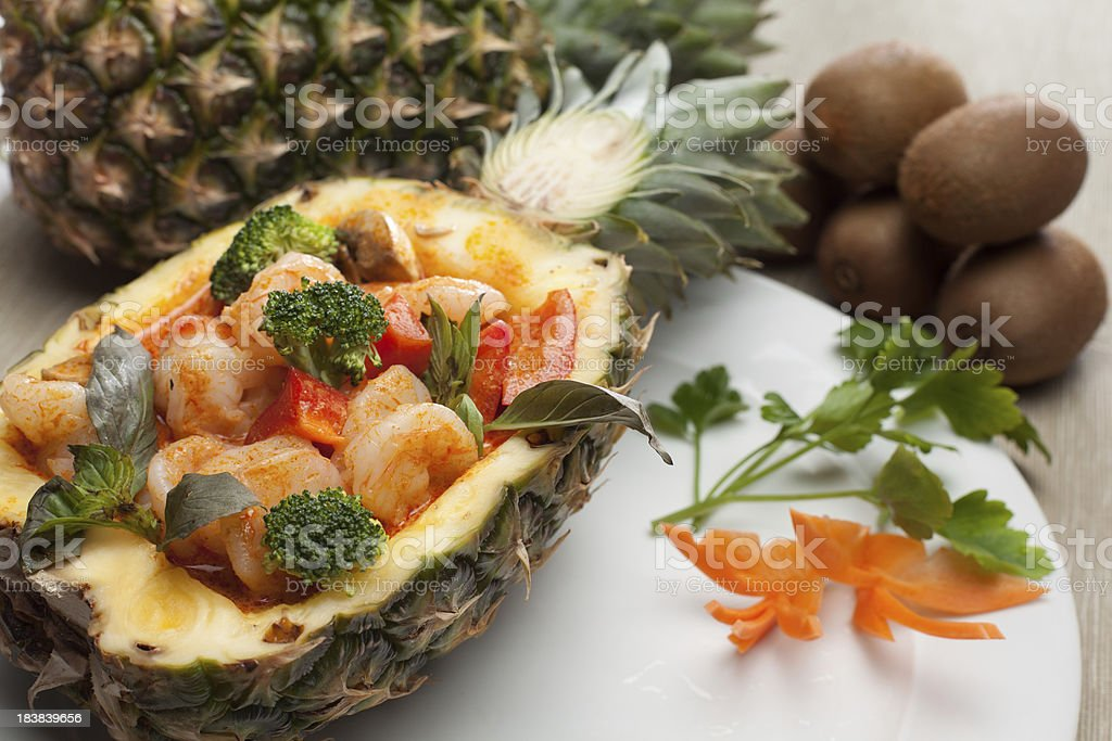 king prawns with pinapple in red curry stock photo