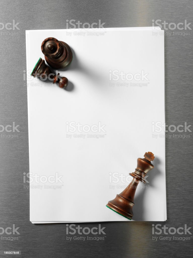 King, Queen and Pawn Chess Pieces on Compurter Paper stock photo
