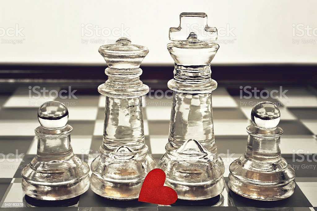 King, queen and pawns on chess board stock photo