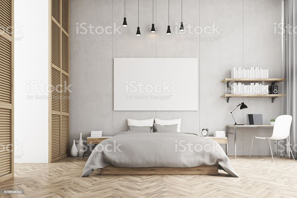 king size bed and a study corner in a bedroom stock photo