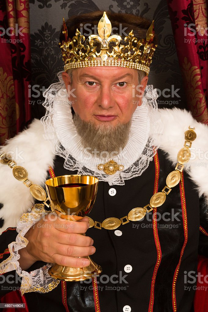 King toasting with wine stock photo