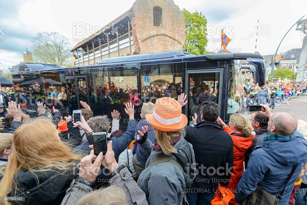 King Willem Alexander and Queen Maxima in the Royal bus stock photo