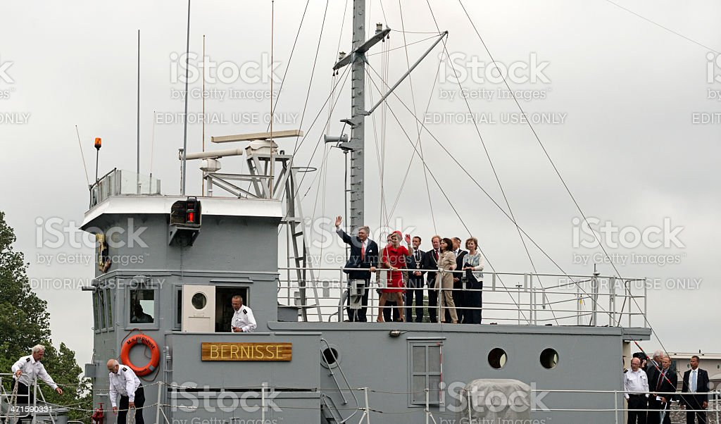 King Willem Alexander and Queen maxima waving from the boat royalty-free stock photo