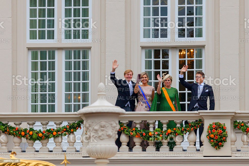 King Willem-Alexander and Queen Máxima waving to the public stock photo