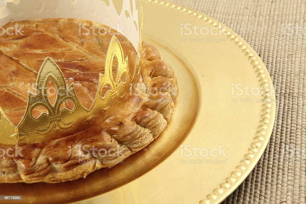 King's cake on a plate on a woven surface stock photo
