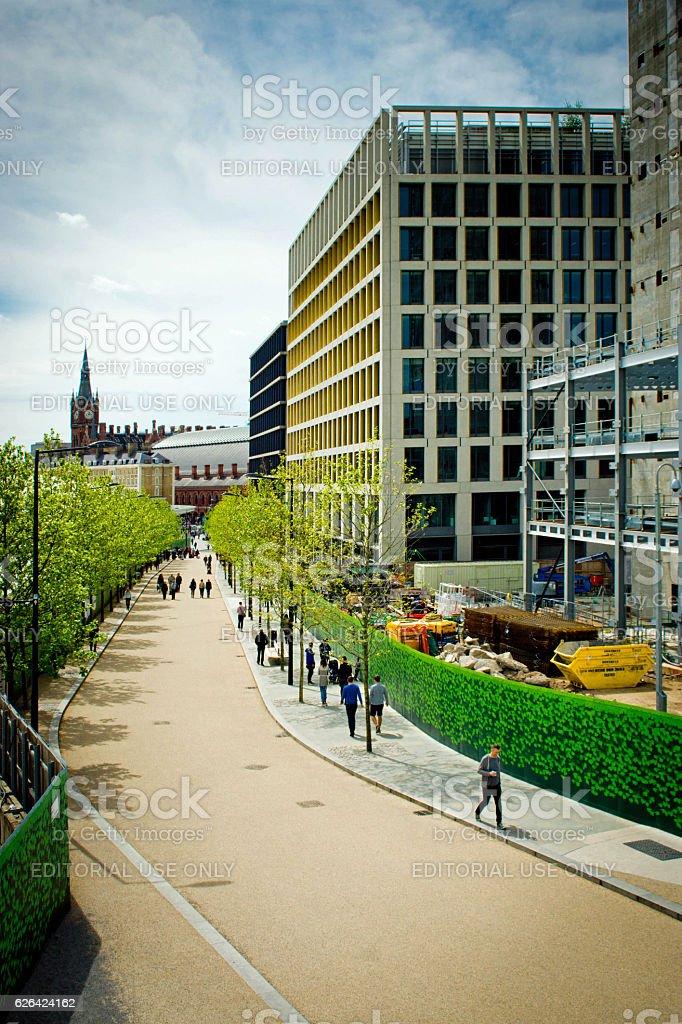 Kings Cross commuters walking past new developments stock photo