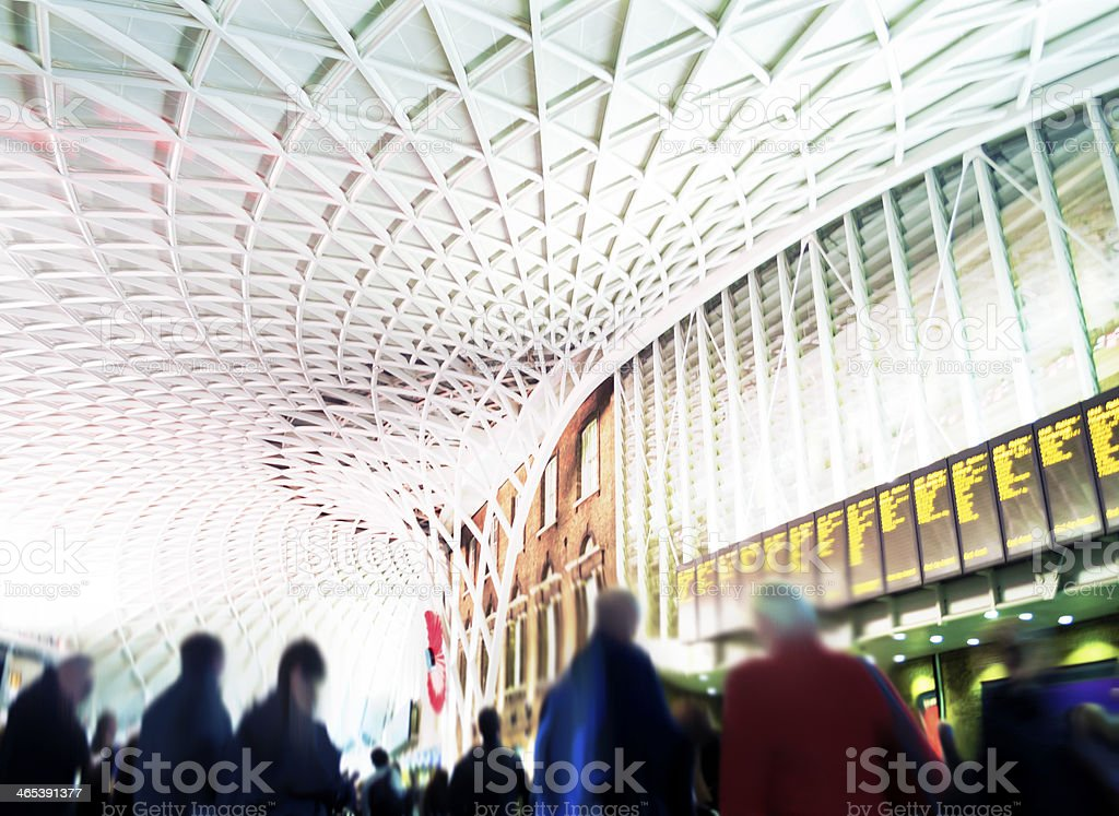 King's Cross Railway Station London - Commuters Looking At Timetables stock photo