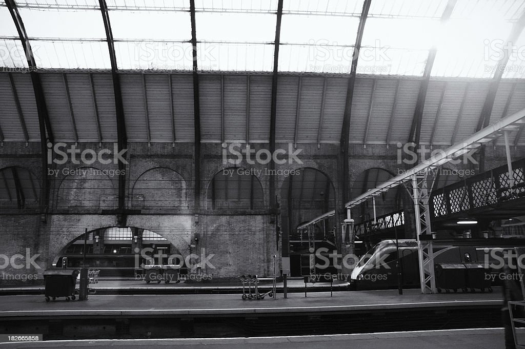 King's Cross Station platform, London, black and white, lens reflection stock photo