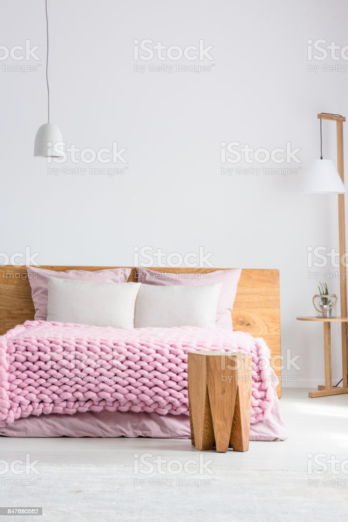 King-size bed in white room stock photo