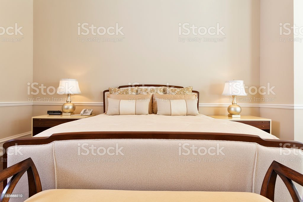 Kingsize Bed with End Tables and Lamps with Copy Space stock photo