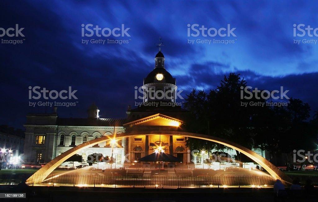 Kingston City Hall and Confederation Park Fountain at Dusk royalty-free stock photo