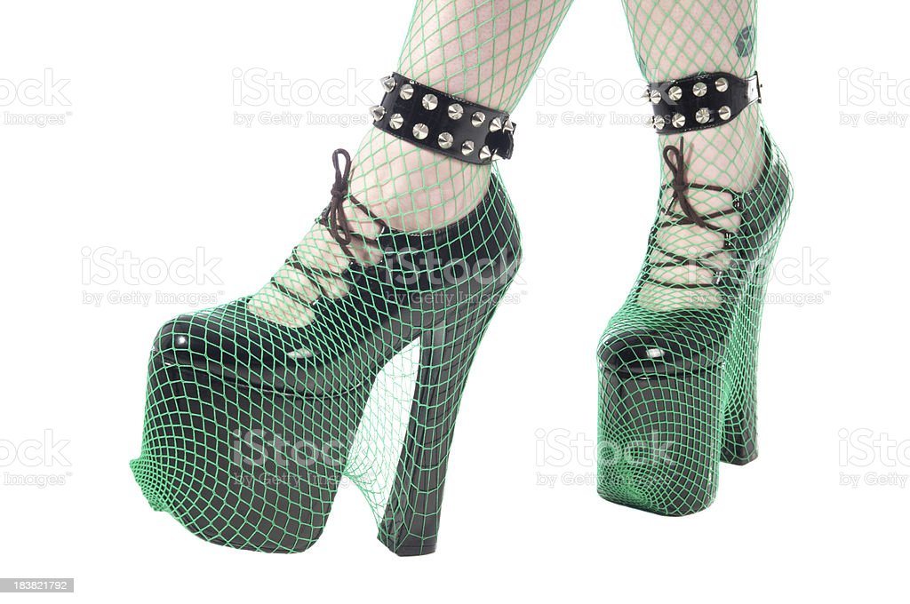 Kinky shoes with green fishnet. stock photo