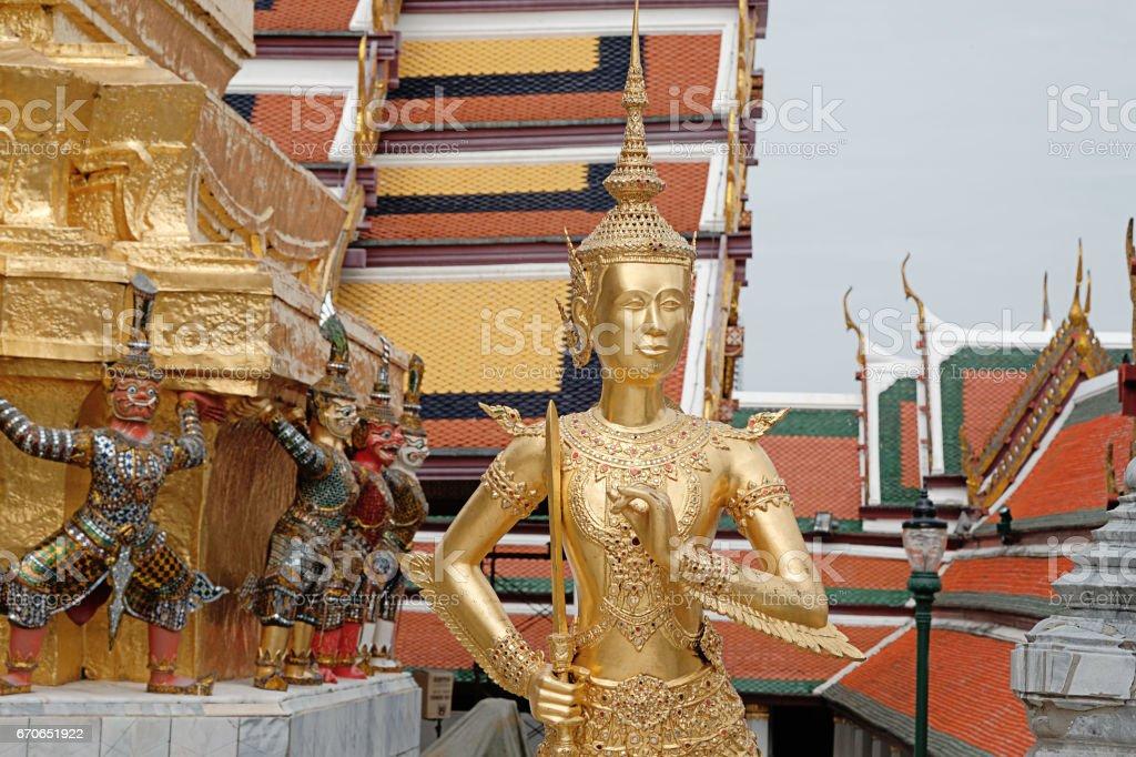 Kinnaree statue holding a sword look gracefully in wat phra keaw. stock photo