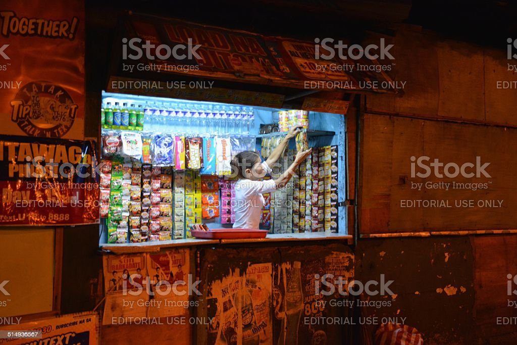 Kiosk in the wall, Ermita ditrict - Manila Philippines stock photo