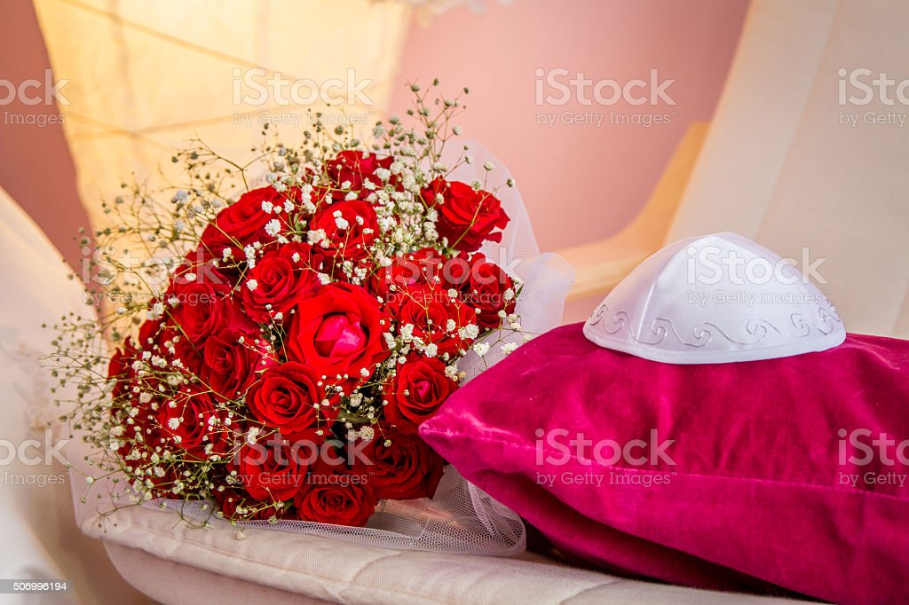 Kippah and bouquet with red roses stock photo