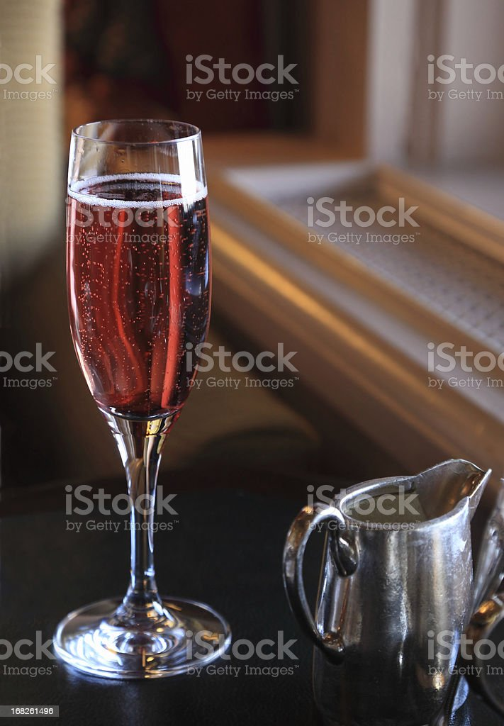 Kir royale in champagne glass stock photo