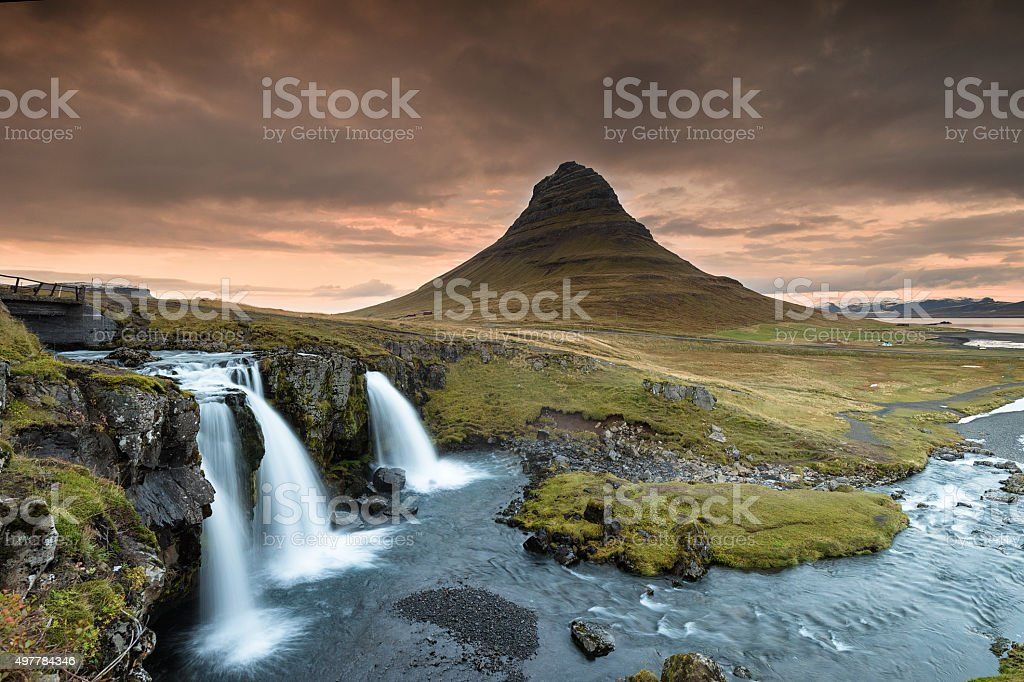 Kirkjufell Mountain and Kirkjufellsfoss Waterfalls Against the Sunset,  Autumn. stock photo