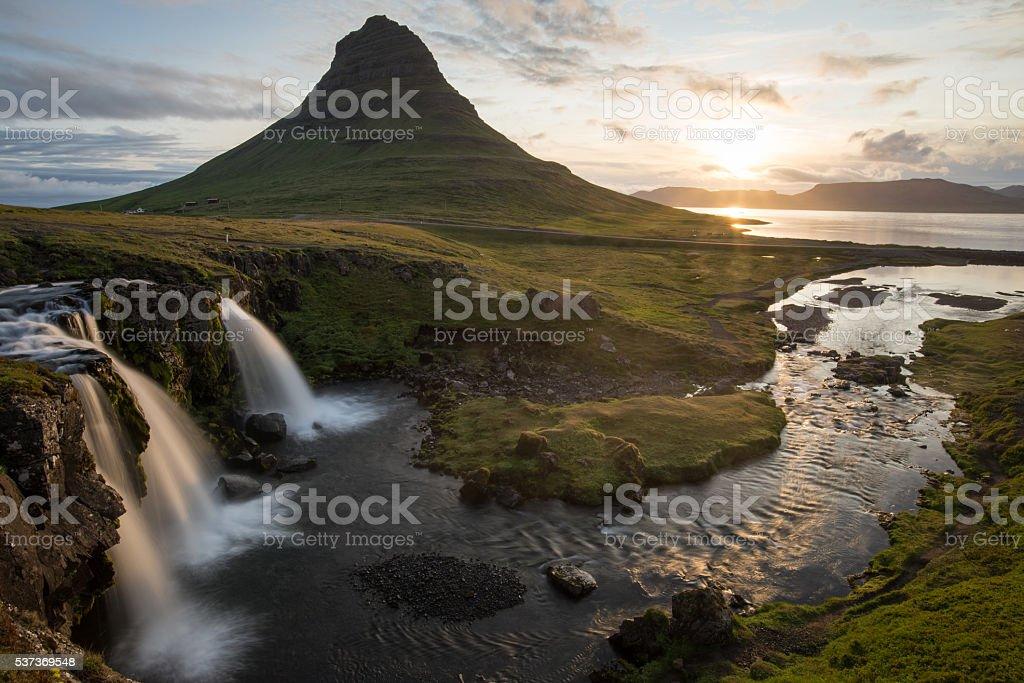 Kirkjufellsfoss and Kirkjufell mountain stock photo