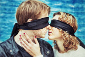 Kiss. Blindfolded Young Couple is kissing