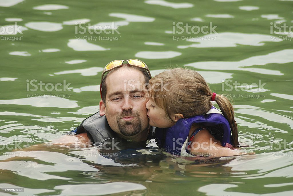 Kiss for Daddy stock photo