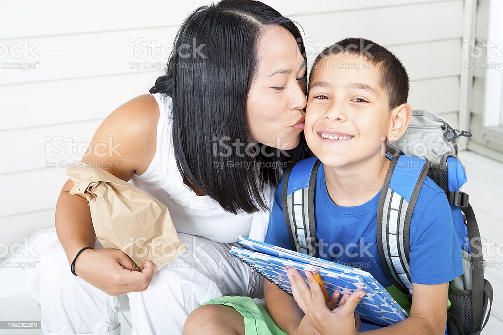 Kiss from mother before school royalty-free stock photo