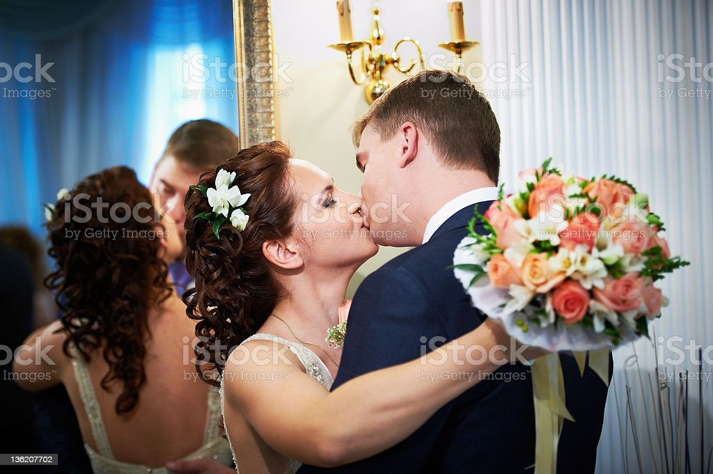Kiss happy bride and groom royalty-free stock photo