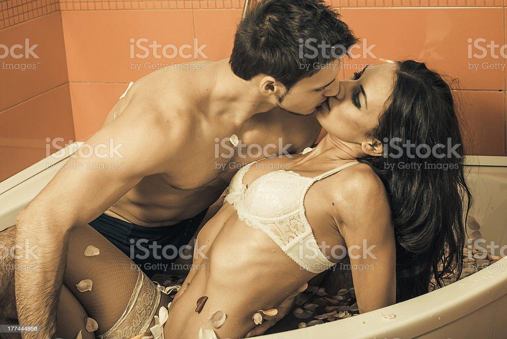 Hot kiss in bathroom