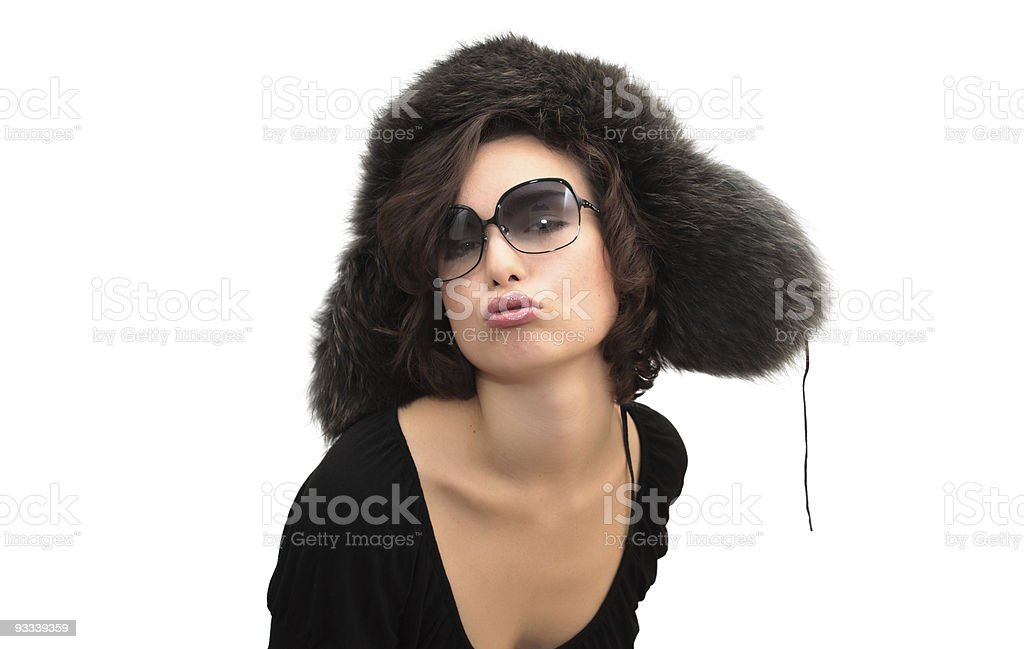 Kiss in ear-flaps fur hat and sunglasses royalty-free stock photo