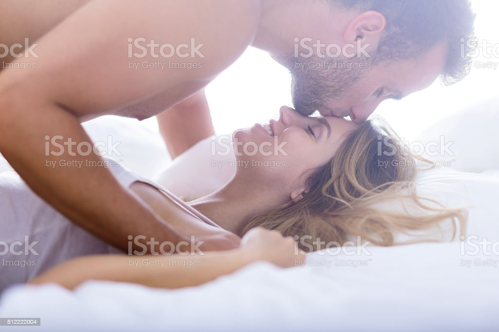 Kiss in forehead stock photo