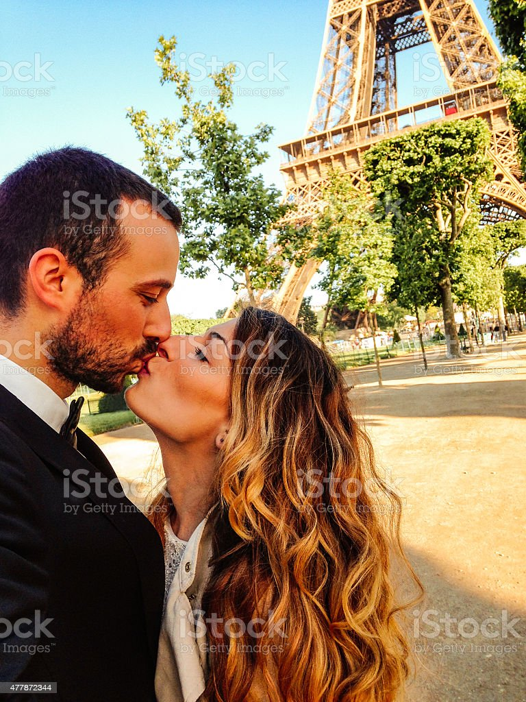 Kiss in the city of love stock photo