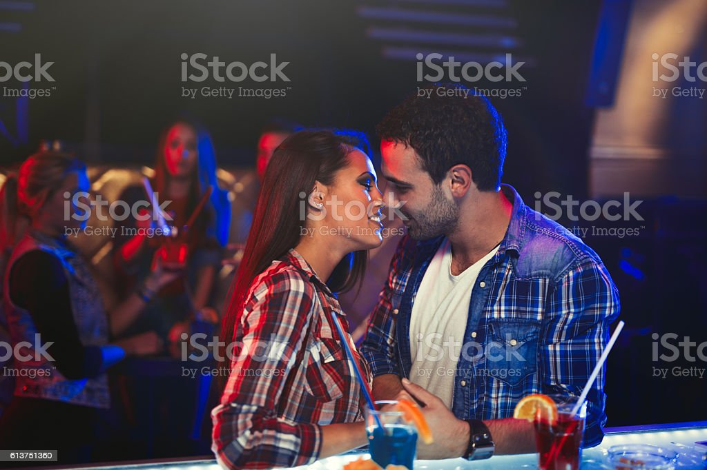 Kiss in the nightclub stock photo