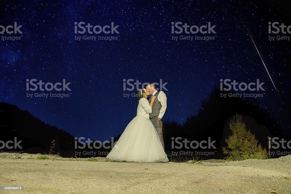 Kiss me till the meteor falls stock photo
