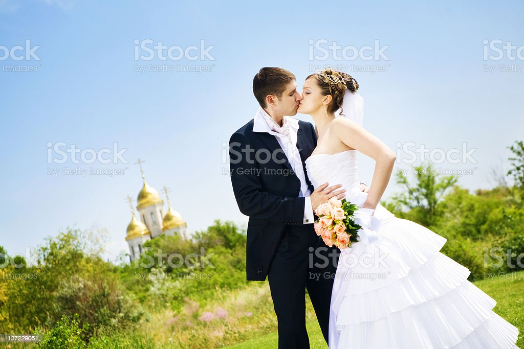 kiss of bride and groom royalty-free stock photo