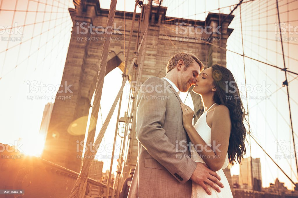 Kiss on Brooklyn Bridge stock photo