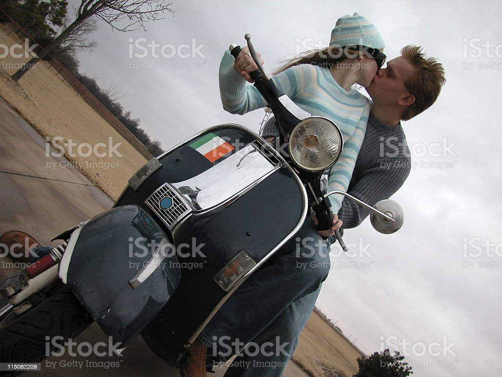 kiss on scooter royalty-free stock photo
