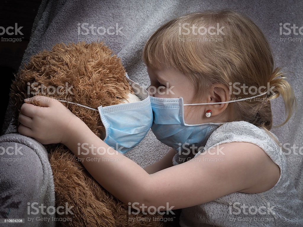 Kiss through the medical mask stock photo