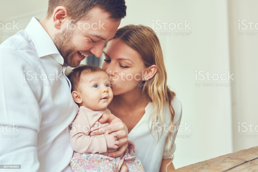 Kisses for baby stock photo
