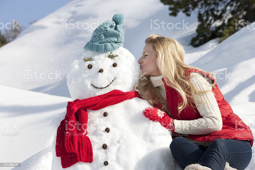Kissing A Snowman stock photo