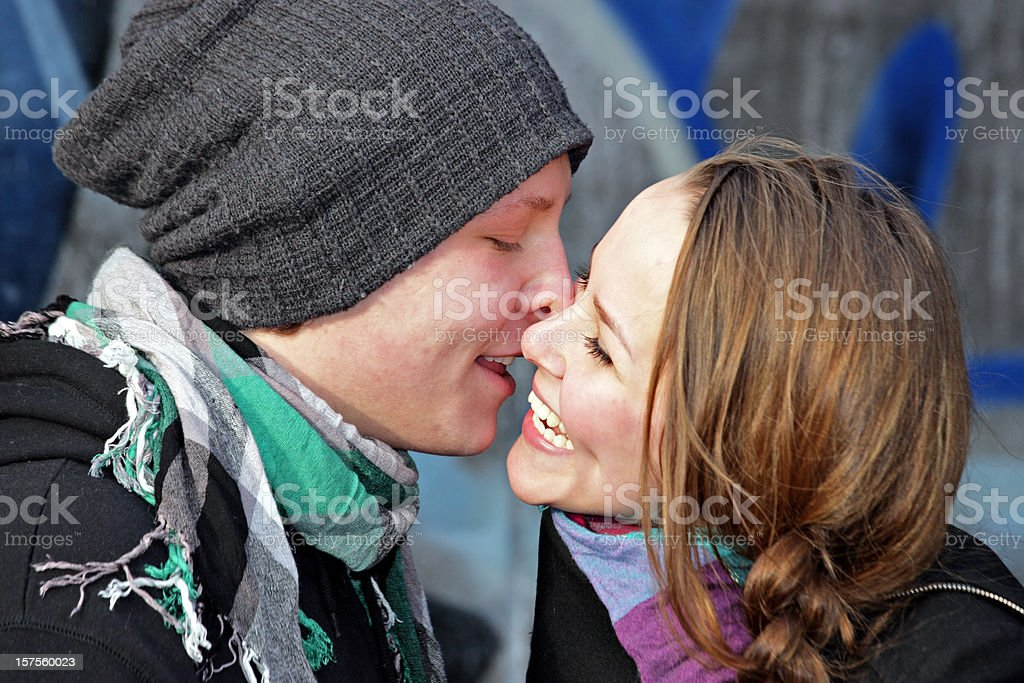Kissing and smiling royalty-free stock photo