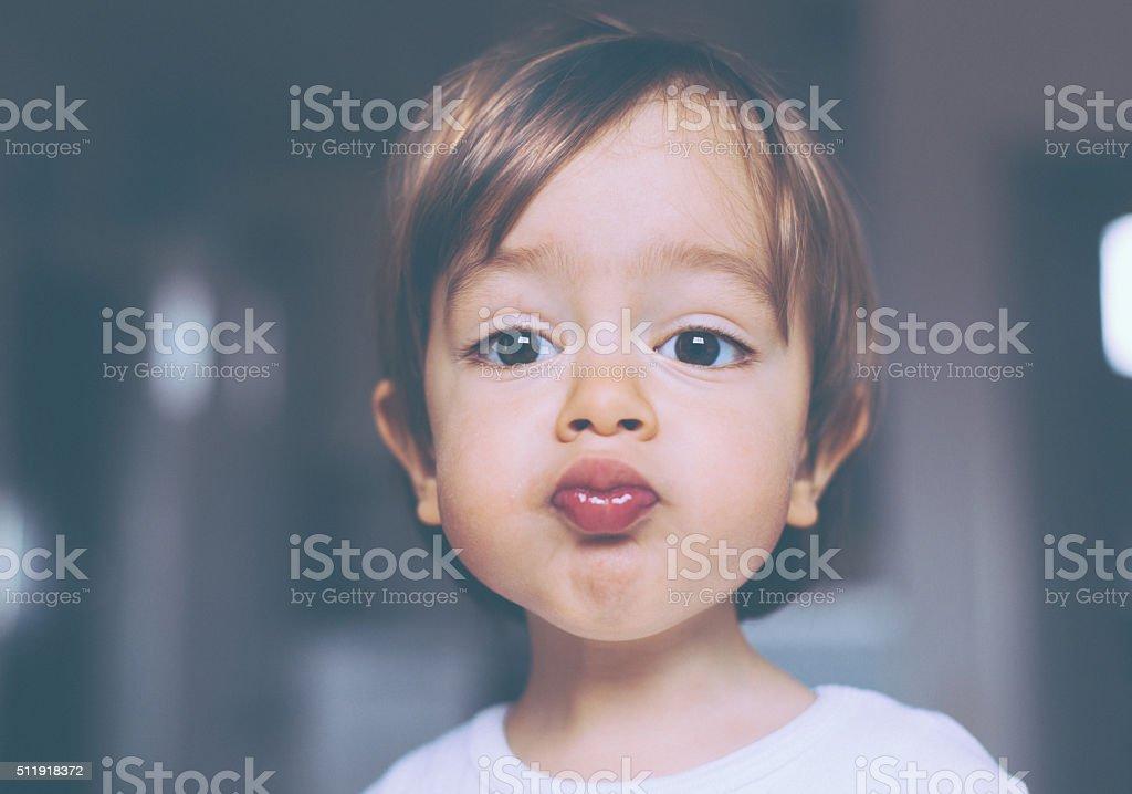 Kissing Boy stock photo