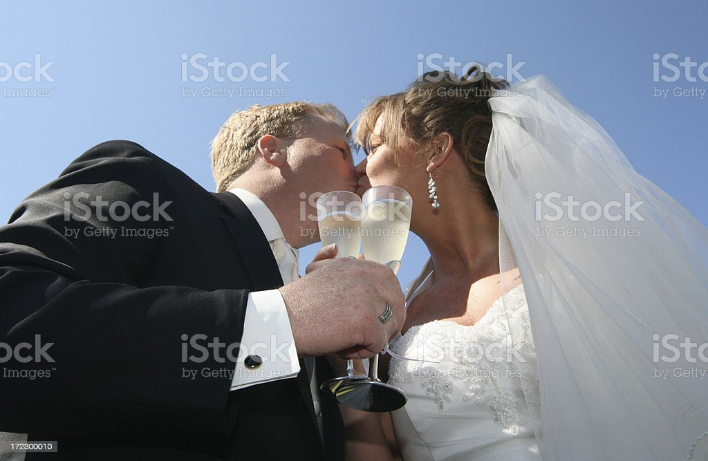 kissing bride and groom royalty-free stock photo