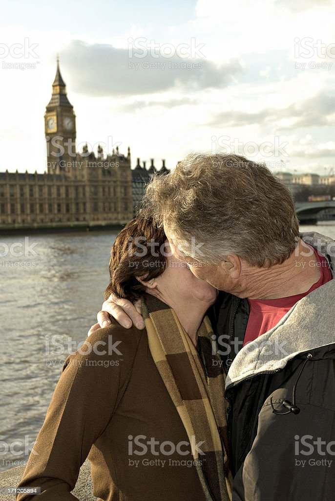 Kissing couple in London, vertical. royalty-free stock photo