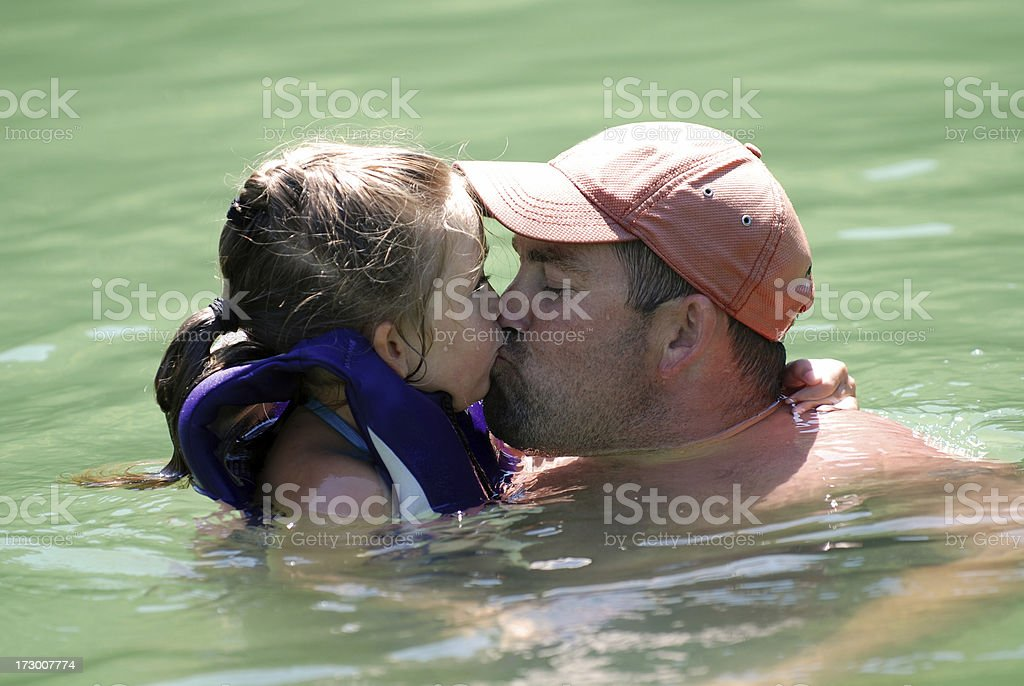 Kissing Daddy in the Lake royalty-free stock photo
