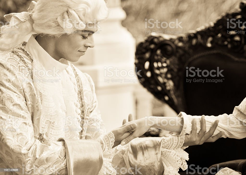 Kissing Hand in Old French Costumes stock photo