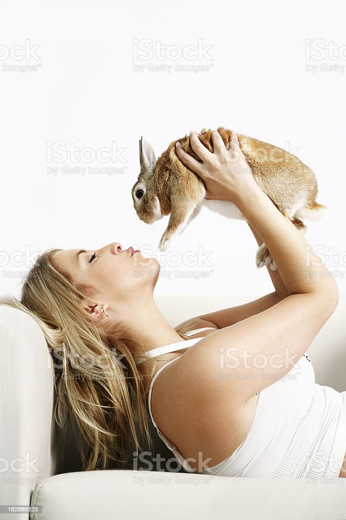 Kissing her bunnty royalty-free stock photo
