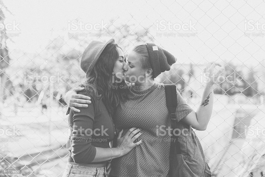 Kissing homosexual couple stock photo