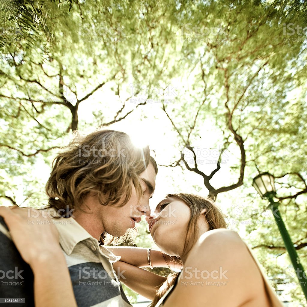 kissing in the park royalty-free stock photo