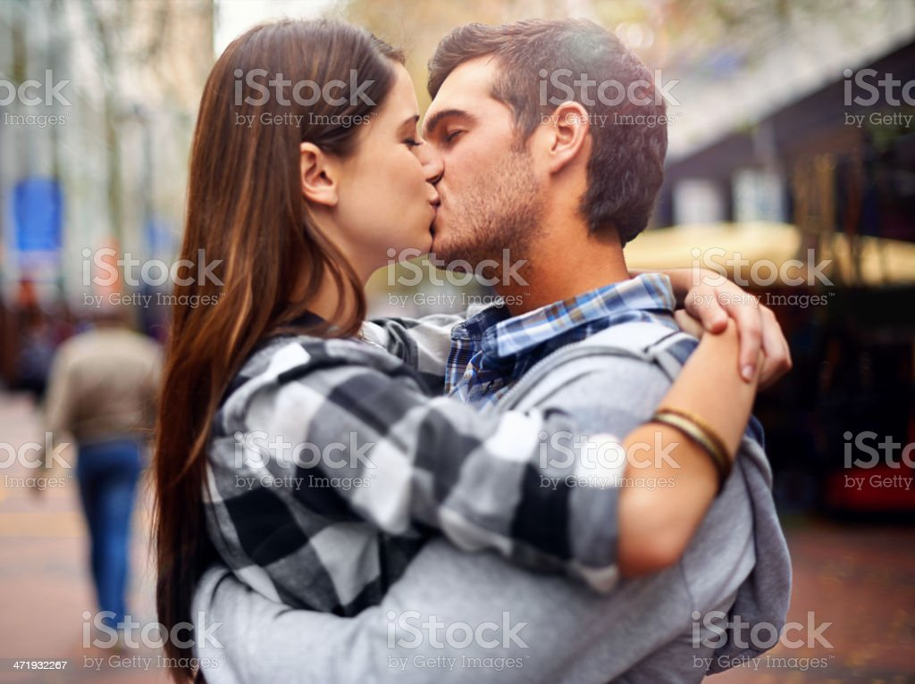 Kissing in the streets stock photo
